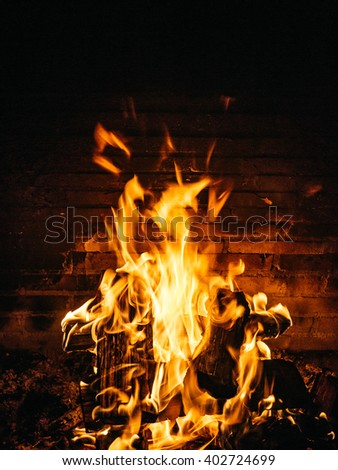Close-up image of a open fireplace on a winter night, Campos do Jordao, Brazil - stock photo