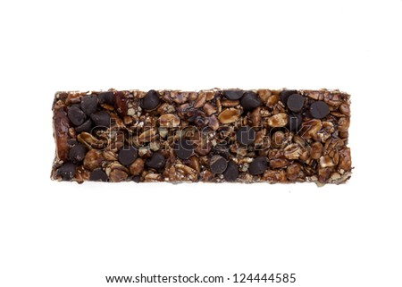 Close-up image of a roasted muesli bar against the white surface - stock photo