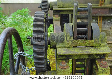 Close up image of a rusty old sluice gate mechanism - stock photo