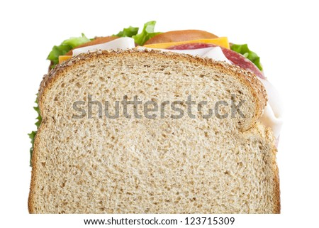 Close-up image of a sandwich with ham and vegetables isolated over the white background - stock photo