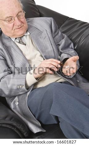 Close-up image of a senior man taking his medication. - stock photo