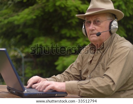 Close-up image of a senior using a laptop - stock photo
