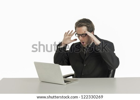 Close-up image of a shocked office man while looking at his laptop on the office table