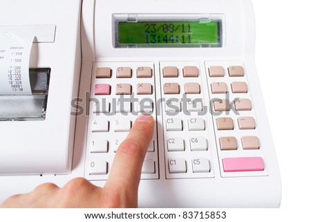 Close-up image of a shop-assistant's hand pressing a key of an electronic cash register in a shop. - stock photo