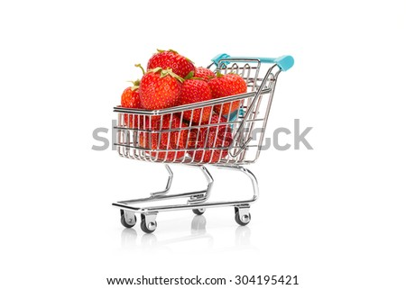 Close up image of a shopping cart filled with strawberries with a small reflection on pure white background. Healthy shopping and eating concept. - stock photo