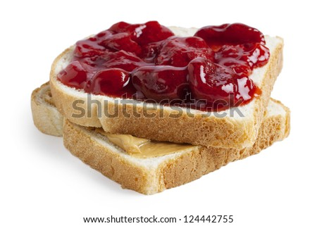 Close-up image of a slice of toasted bread with a spread of strawberry jam and peanut butter - stock photo