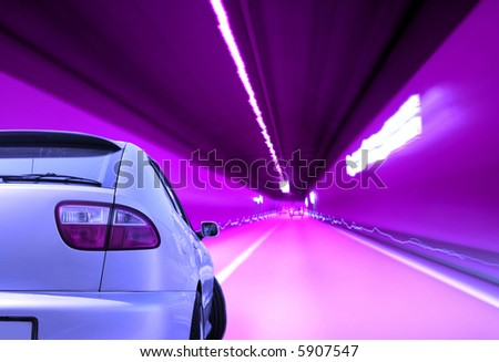 Close-up image of a sport car in a tunnel - stock photo