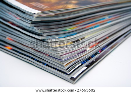 Close-up image of a stack of magazines