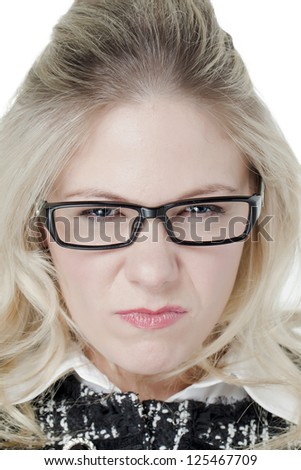 Close-up image of a stressed woman wearing glasses in a white background - stock photo