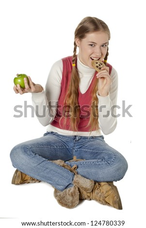 Close-up image of a teenager eating cookies - stock photo