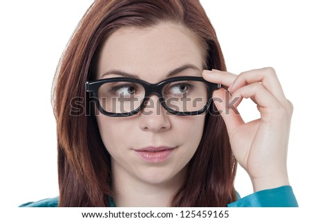 Close-up image of a woman's face wearing eyeglasses looking away on a white background