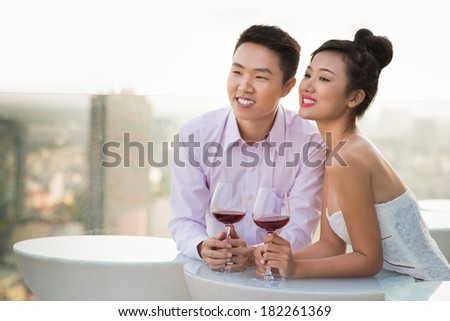 Close-up image of a young couple standing at a cafe and dreaming about their future  - stock photo