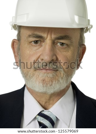 Close-up image of an angry old man wearing hard hat isolated on a white background - stock photo