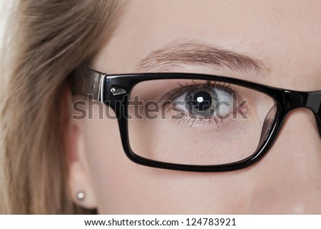Close-up image of an eye of a woman with eye wear