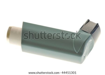 Close up image of an inhaler for asthma. White background studio picture - stock photo