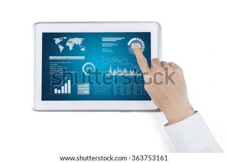 Close-up image of an office worker using a touchpad to analyze financial statistics
