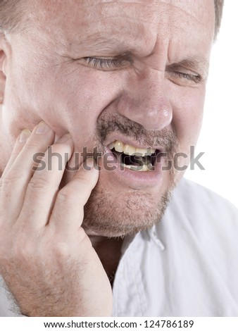Close up image of an old man having a toothache