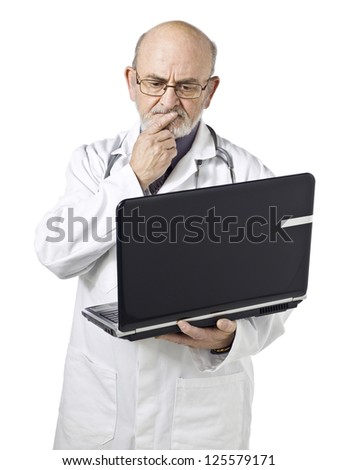 Close-up image of an upset male doctor holding laptop isolated on a white background - stock photo