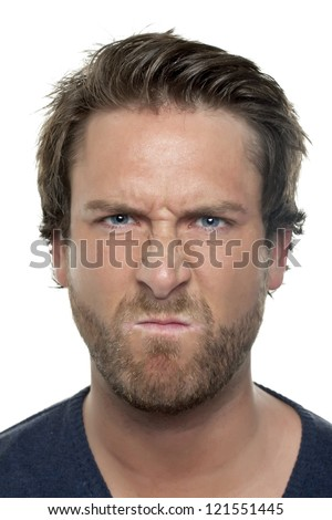 Close-up image of angry face of man isolated on a white background