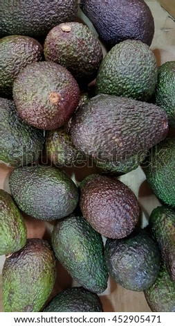 Close up image of avocados.  Image has grain or noise and soft focus when view at full resolution(Shallow DOF, slight motion blur) - stock photo