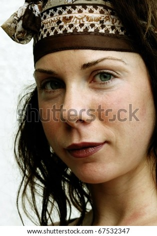 Close up image of beautiful caucasian female wearing bandana - stock photo