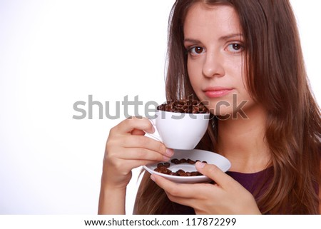 Close up image of beautiful girl with cup of coffee beans