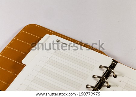 Close up image of black note book organizer against white background - stock photo