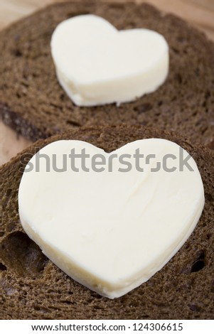 Close up image of bread with heart shape butter - stock photo