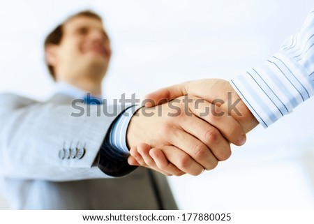 Close up image of business handshake at meeting. Partnership concept - stock photo