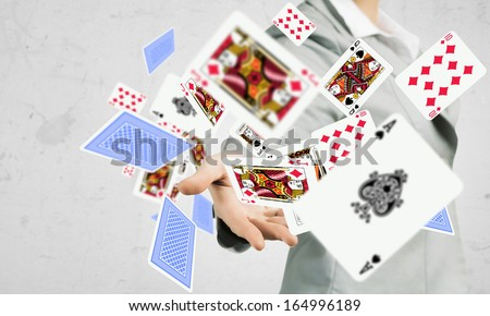 Close-up image of businesswoman throwing card deck - stock photo