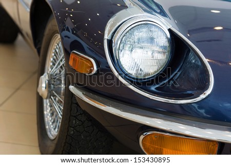Close up image of car headlight. Front view - stock photo