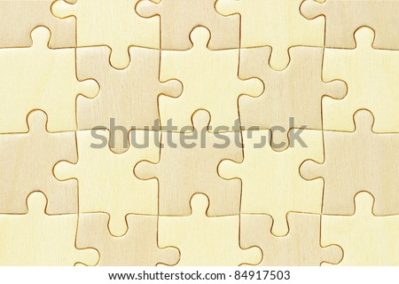 Close up image of checkered wooden jigsaw puzzle background - stock photo