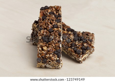 Close-up image of chewy granola bars on a wooden table - stock photo