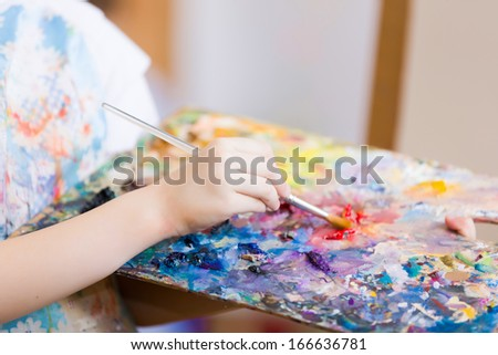 Close up image of child';s hands with palette