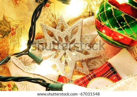 Close up image of Christmas decorations with lights ornaments and starts..