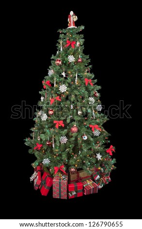 Close-up image of Christmas tree surrounded by gifts isolated on a dark background