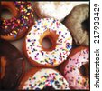 close up image of color donuts in a box - stock photo