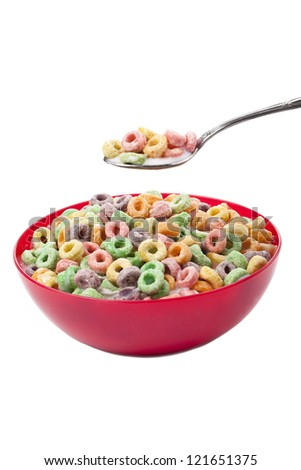 Close up image of colorful cereal rings in red bowl against white background