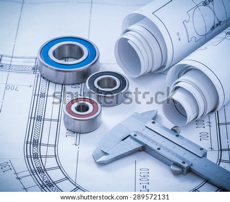 Close up image of construction drawings slide caliper rolling bearings on blueprint architecture and building concept. - stock photo