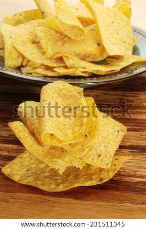 Close-up image of corn chips placed on cutting board - stock photo