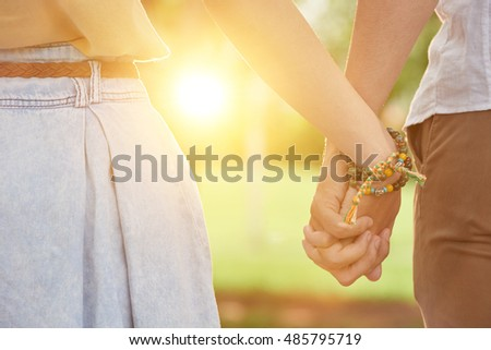 Close-up image of couple holding hands when walking outdoors