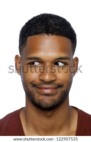 Close up image of dark guy gesturing a funny face against white background - stock photo