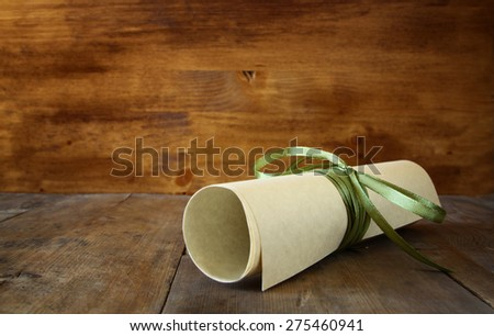 close up image of education diploma over wooden table. selective focus  - stock photo