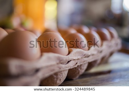 Close up image of eggs with shallow depth of field on a kitchen table ready to be used for cooking or baking. - stock photo