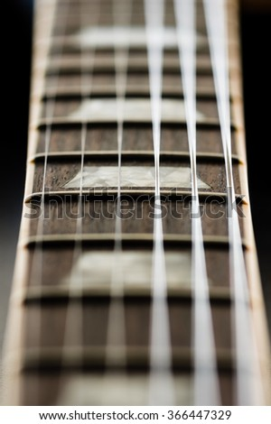 Close up image of electric guitar fingerboard