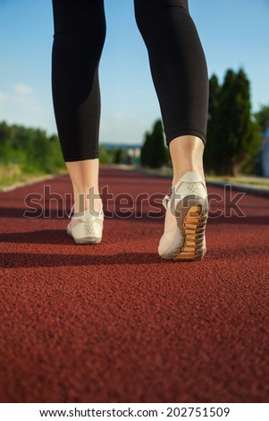 Close Up Image Of Female Fitness Shoes During Training Outside - stock photo