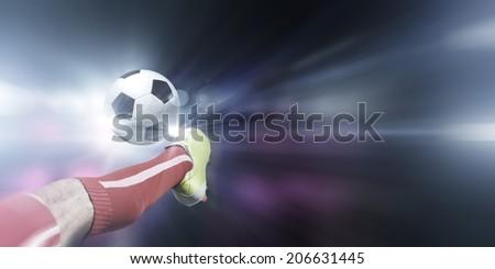 Close up image of footballer foot kicking the ball - stock photo