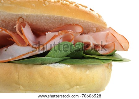 Close-up image of fresh made sandwich with spinach and salami