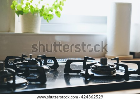 close up image of Gas stove in the kitchen,Interior of rural kitchen - stock photo
