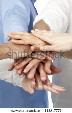 Close up image of group of business people overlapping hands